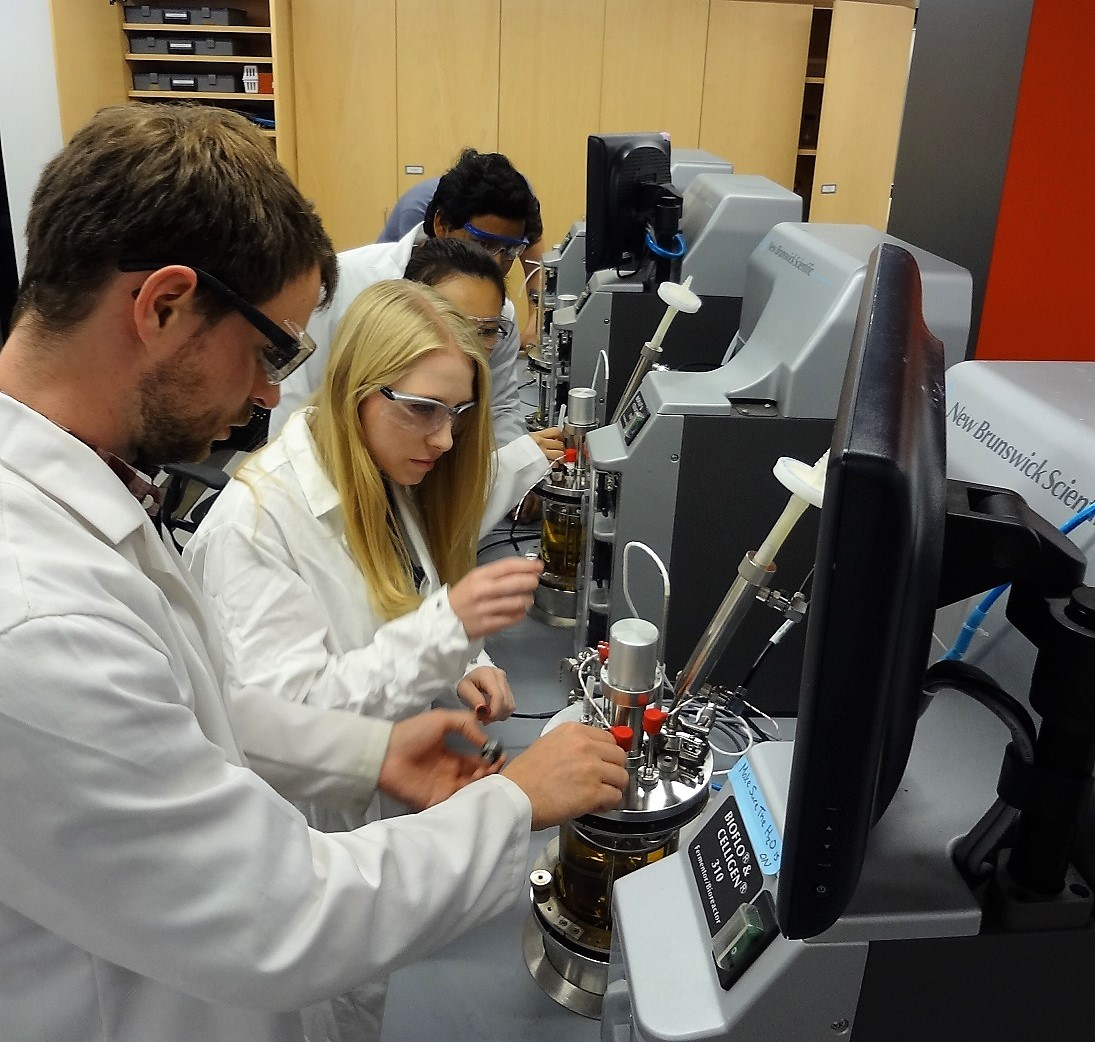 Students in lab with bioreactors